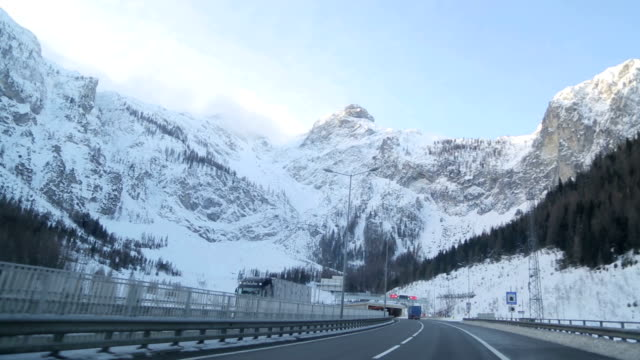 winter driving in austria - articulated lorry stock videos & royalty-free footage