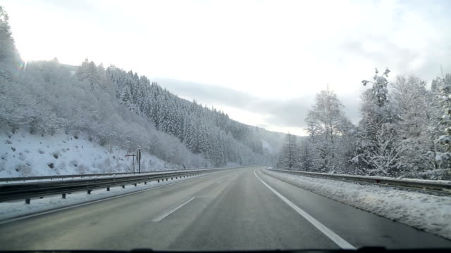 winter driving in austria - car point of view stock videos and b-roll footage
