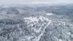 Winter. Drone's flight over snow-covered mountains, winter landscape, pine woodland, Finland, Taiga, Nature, Outdoors