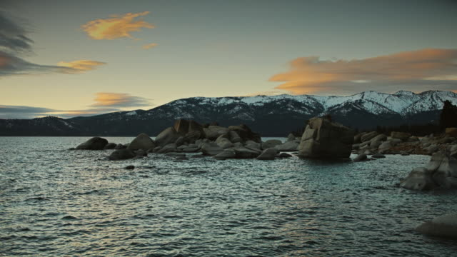 winter dusk at lake tahoe - boulder rock stock-videos und b-roll-filmmaterial