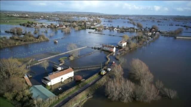 farmers yet to receive govenment compensation lib winter 2014 england somerset levels view / aerial flooded fields and house sin somerset levels - somerset levels stock videos and b-roll footage