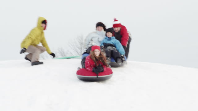 winter fun - tubing stock videos and b-roll footage