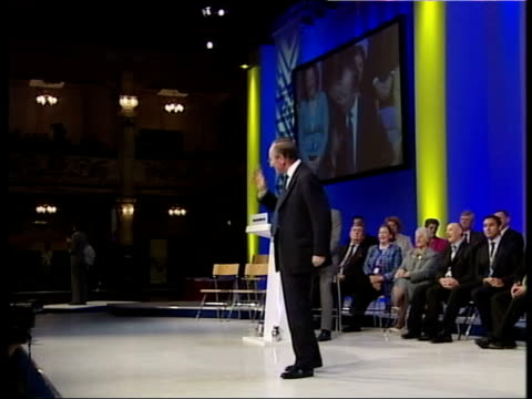 malcolm rifkind mp onto stage to applause sot side rifkind speaking to conference malcolm rifkind mp speech sot - as king henry viii said to each of... - top of the pops stock videos & royalty-free footage