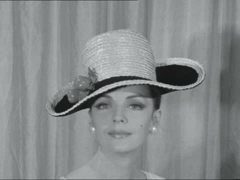 winter hat fashions; ** digitised version of fs111163002 england: london: dorchester hotel: int concertina hat: large hat & scarf - hat off & scarf... - valley stock videos & royalty-free footage