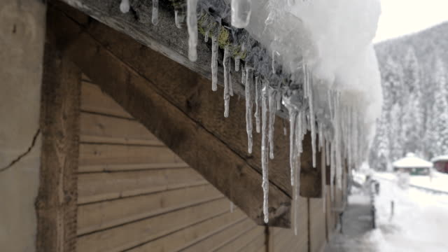 winter icicles melting on the roof - roof stock videos & royalty-free footage