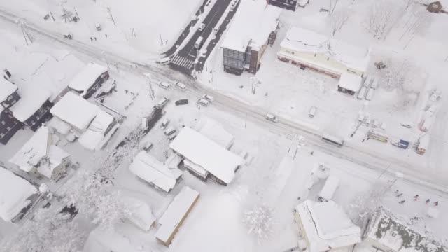 winter in niseko, japan. (4k aerial videos) - deep snow stock videos & royalty-free footage