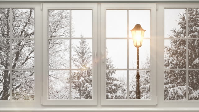 winter landscape behind the window | loopable - snowing stock videos & royalty-free footage