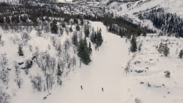 winter landscape skiing aerial view on white slopes - skiing stock videos & royalty-free footage
