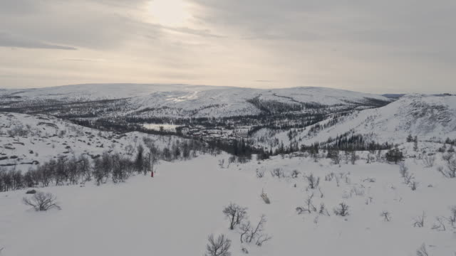 winter landscape skiing aerial view on white slopes - sweden stock videos & royalty-free footage