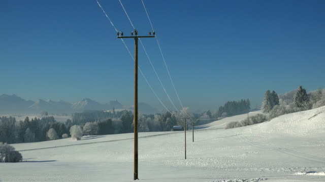 winter landscape, trauchgau near fuessen, allgaeu alps, swabia, bavaria, germany - telephone line stock videos & royalty-free footage