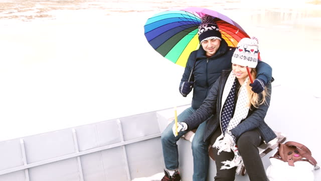 Winter love story in Colorful umbrella