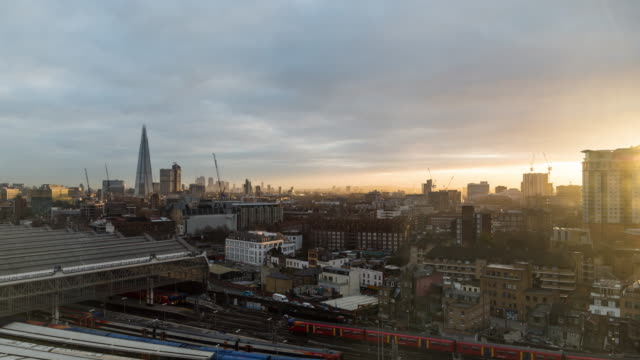 A winter morning time lapse of Waterloo Station (London, UK) featuring the sun dramatically breaking through the clouds with trains arriving and departing and views of the Shard in the background