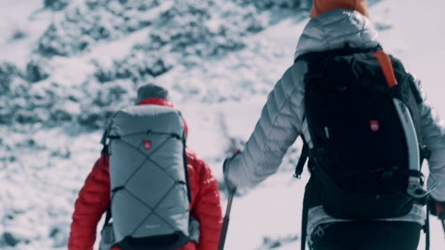 Winter mountain adventure. Young couple on a trail