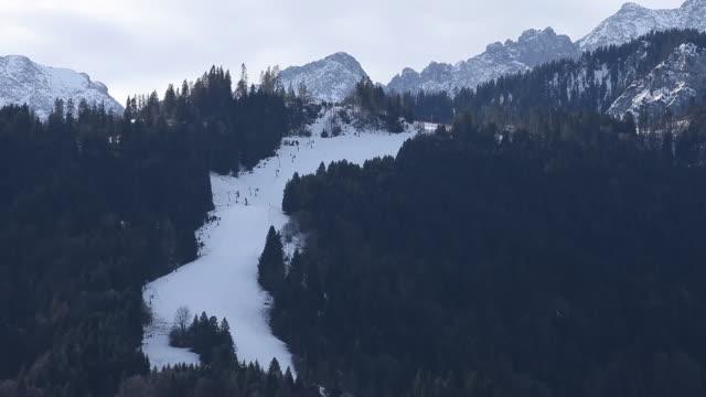 winter mountain landscape with ski slope at bavarian alps garmischpartenkirchen bayern germany on wednesday january 8 2020 - garmisch partenkirchen stock videos & royalty-free footage