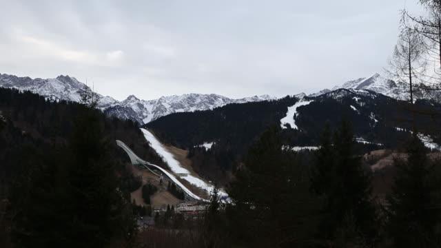 winter mountain landscape with ski slope at bavarian alps garmischpartenkirchen bayern germany on wednesday january 8 2020 - bavarian alps点の映像素材/bロール