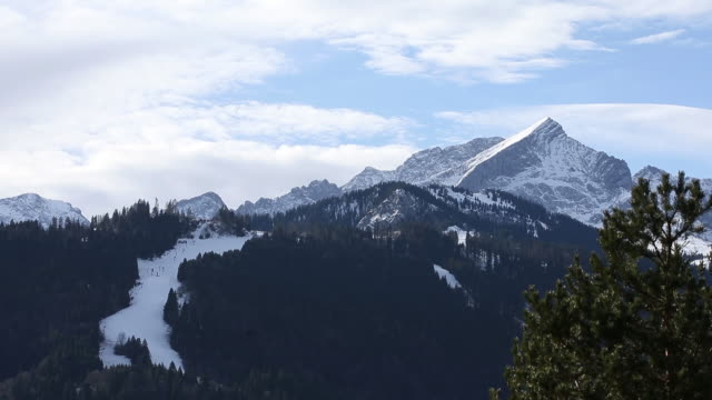 winter mountain landscape with ski slope at bavarian alps garmischpartenkirchen bayern germany on wednesday january 8 2020 - mountain stock videos & royalty-free footage