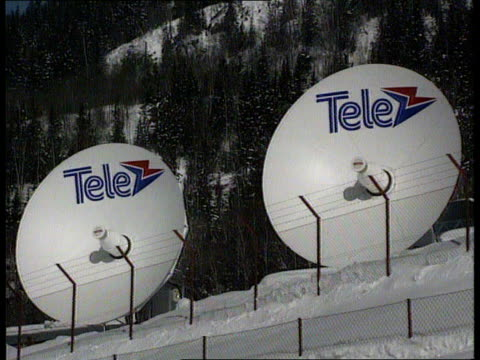 stockvideo's en b-roll-footage met harding and kerrigan compete itn norway lillehammer satellite dishes on snow covered slopes ms two ditto int cms monitor showing extract of nbc news... - 1994