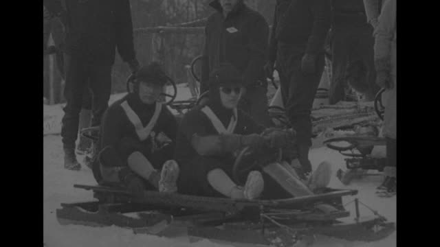 winter olympics lake placid new york / athletes in 2man bobsled are introduced / american team brothers hubert and curtis stevens / german team hanns... - 1932 winter olympics lake placid stock videos and b-roll footage