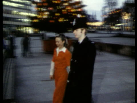 stockvideo's en b-roll-footage met torvill dean ext nottingham ms christopher dean along in policeman's uniform with jayne torvill - 1994