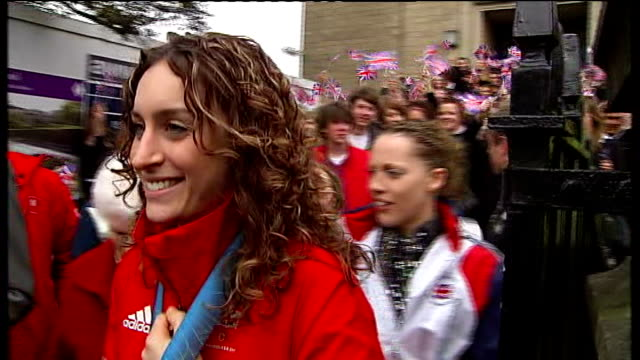 Amy Williams opentop parade through Bath ENGLAND Somerset Bath EXT Amy Williams wearing her gold medal then along as shows gold medal to schoolgirls...