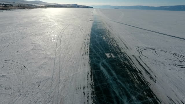 Winter on Lake Baikal. Ice road along the coast of the Olkhon island