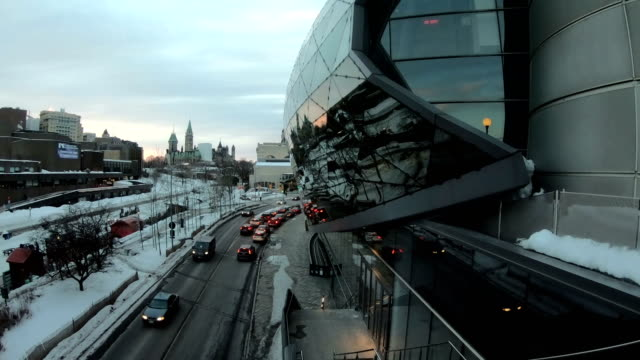 winter ottawa street view, the background is the canadian parliament tower. - ottawa stock videos & royalty-free footage