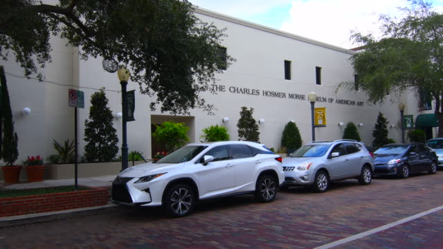 winter park florida charles hosmer morse museum of american art tiffany stained glass museum exterior entrance with people walking 4k, - no parking sign stock videos & royalty-free footage