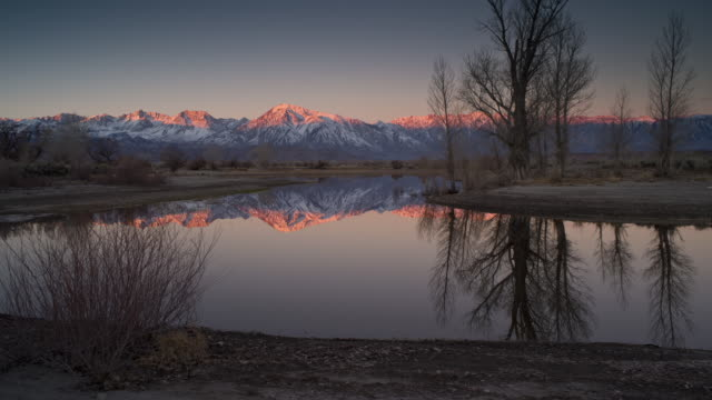 winter reflect in a pond in owens valley near the sierra nevada mountains in bishop, california in winter. - californian sierra nevada stock videos & royalty-free footage
