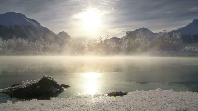 winter, river steaming in morning sun - winter stock-videos und b-roll-filmmaterial