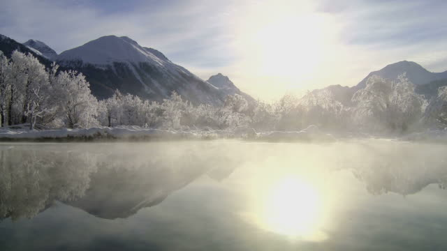 Winter, river steaming in morning sun