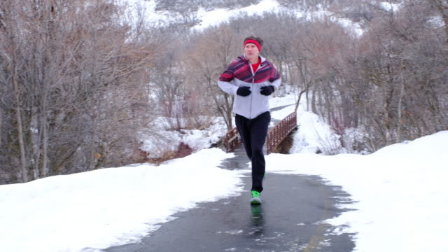 winter running - one mid adult man only stock videos & royalty-free footage