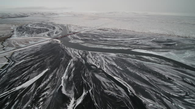 winter scene of river course in iceland - riverbank stock videos & royalty-free footage