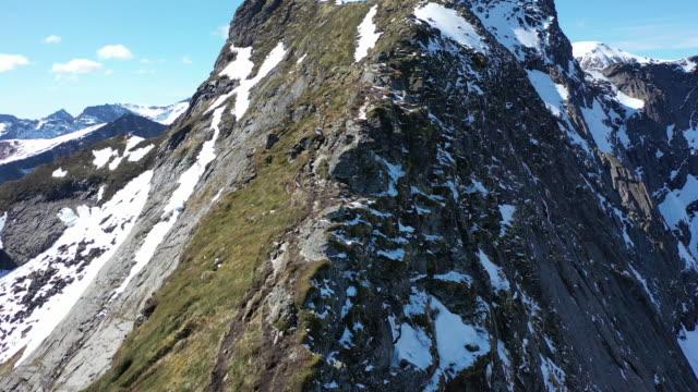winter scenery of reine village and reinebringen mountain / lofoten islands, norway - nordland county stock videos & royalty-free footage