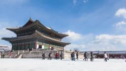 Winter scenery time lapse of people touring Korea Gyeongbokgung Palace.