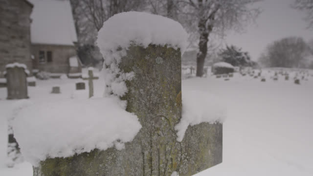 winter snow falls onto village church graveyard, oxfordshire, england - falls church stock videos & royalty-free footage