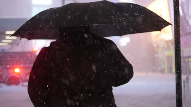 winter snow storm blizzard in new york city. snowfall background shot in slow motion