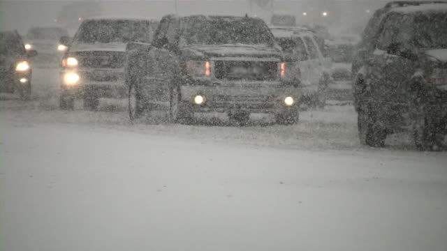 stockvideo's en b-roll-footage met winter snowstorm. van lost control. car traffic on slippery road. - sneeuwstorm