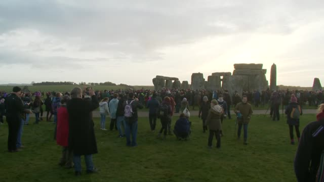 winter solstice people gather at stonehenge to mark the end of the longest night of the year england wiltshire stonehenge various of people gathered... - solstice stock videos & royalty-free footage