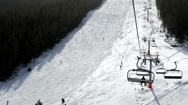 winter sport on vacation - inquadratura dalla sciovia video stock e b–roll