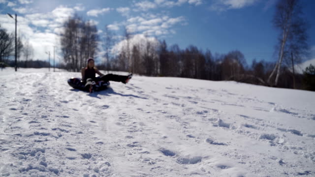 winter sports with snow. sledding - fun in the mountains. winter fun - sliding stock videos & royalty-free footage