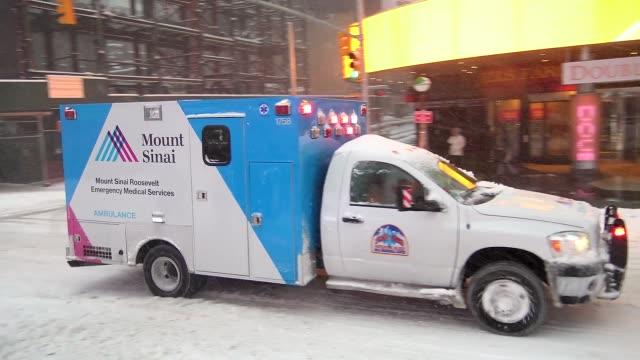 Winter storm Jonas on January 23 2016 / Emergency vehicle ambulance traverses Times Square during east coast blizzard in Times Square during the...