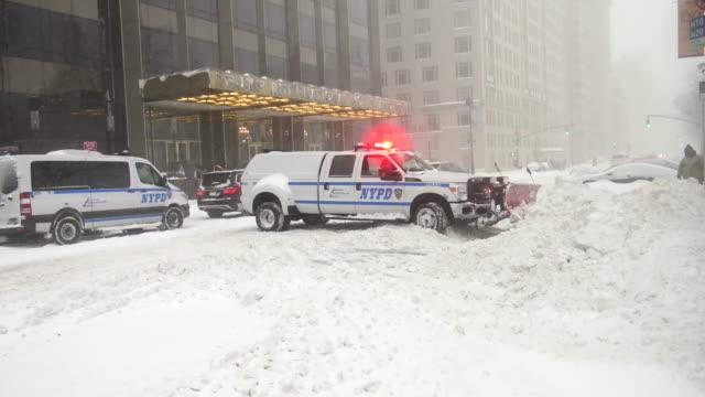 winter storm jonas on january 23 2016 / nypd vehicle plowing snow / columbus circle 59th street manhattan new york city usa - snow vehicle stock videos and b-roll footage