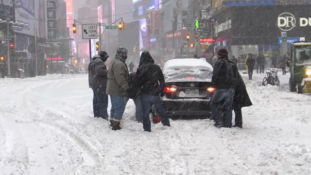 Winter storm Jonas on January 23 2016 / Stranded car in Times Square during east coast blizzard in Times Square during the morning Midtown Manhattan...