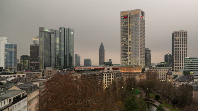 A winter sunrise time lapse of central Frankfurt am Main, Germany, on an exceedingly overcast morning, featuring multiple skyscrapers