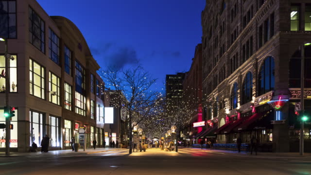 a winter time lapse at dusk of the 16th street mall in denver, co, with pedestrian and bus traffic with trees decorated for the holidays - filiz stock videos & royalty-free footage