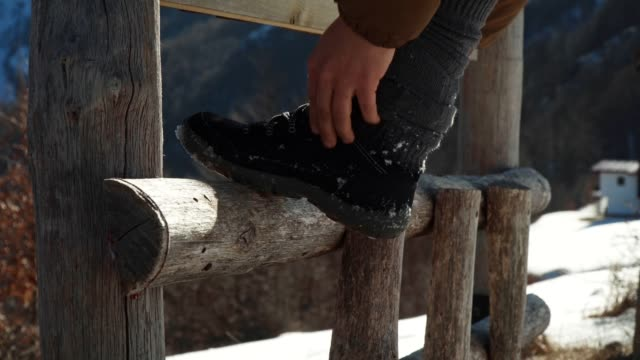 Winter Traveler, Close-Up Shot of One Young Woman Tourist Tying Shoelaces, Winter Sport, Travel, Exploration, Adventure, Tourism, Determination, Athlete, Outdoors, Mountain Hiking, Backpacker, Alps