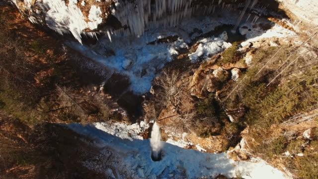 AERIAL Winter waterfall in Julian Alps