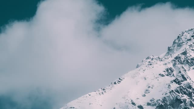 winter wonderland. snowcapped mountains. moving clouds - natural pattern stock videos & royalty-free footage