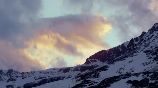 winter wonderland. snowcapped mountains. moving clouds - etereo video stock e b–roll