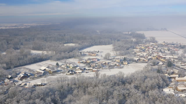 AERIAL Wintry countryside surrounding villages